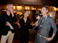 Chefs Bobby Flay, right, and Giada De Laurentis, center, and Bob App´tit editor-in-chief Adam Rapoport, left, speak to the crowd at Caesars Palace during Vegas Uncork'd in Las Vegas on Thursday, May 8, 2014.(Photo by Isaac Brekken for Vegas Uncork'd by bon app´tit)